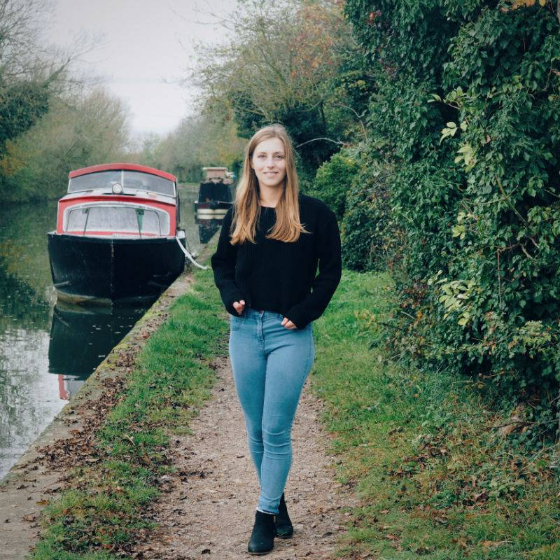 girl out on an autumn walk beside the canal