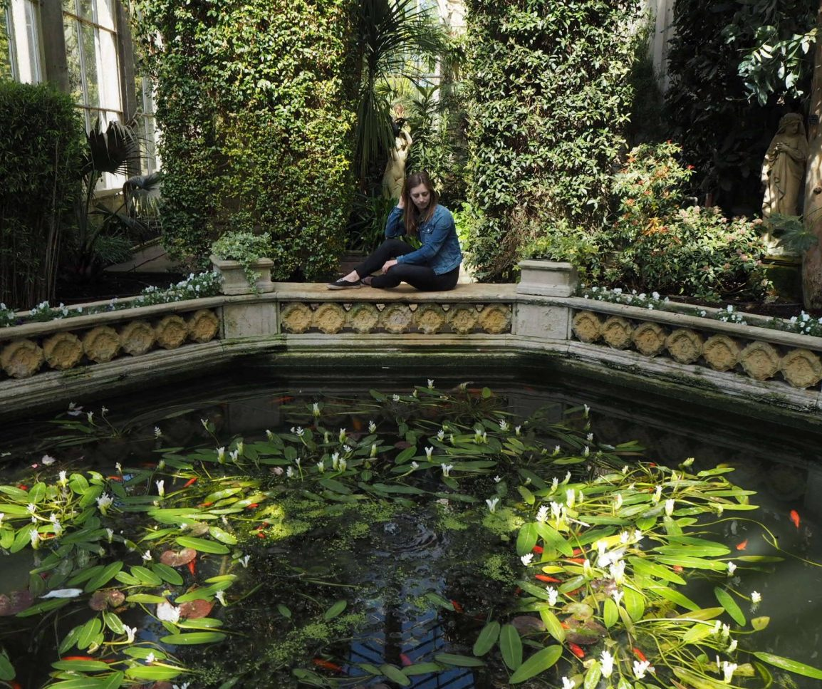Girl looking at fish pond at Castle Ashby Gardens