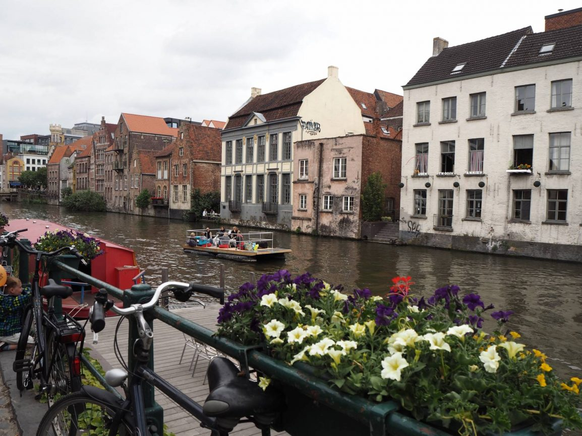 Walking along the canal in Ghent during a Weekend in Belgium