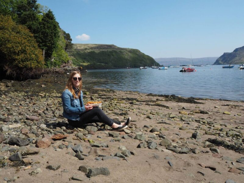 Eating fish and chips in Portree during a road trip to the Isle of Skye