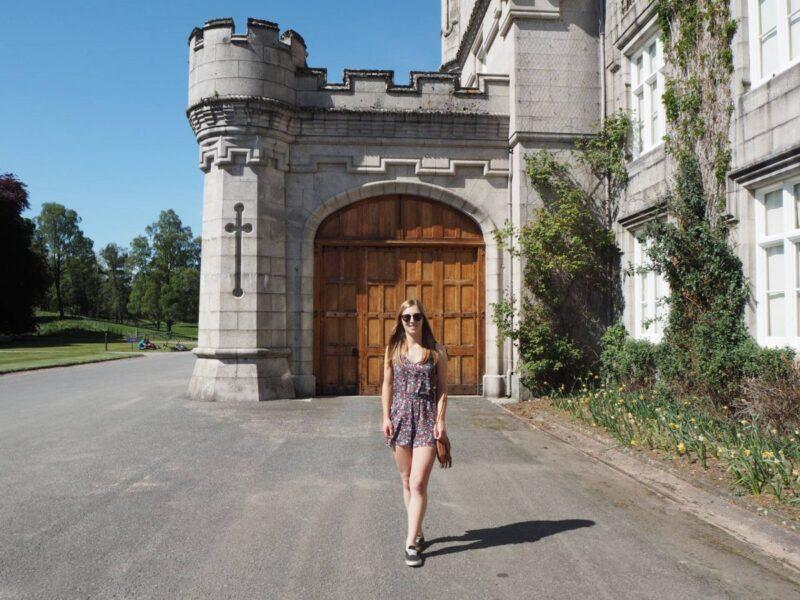 Girl stood outside a door into Balmoral Castle