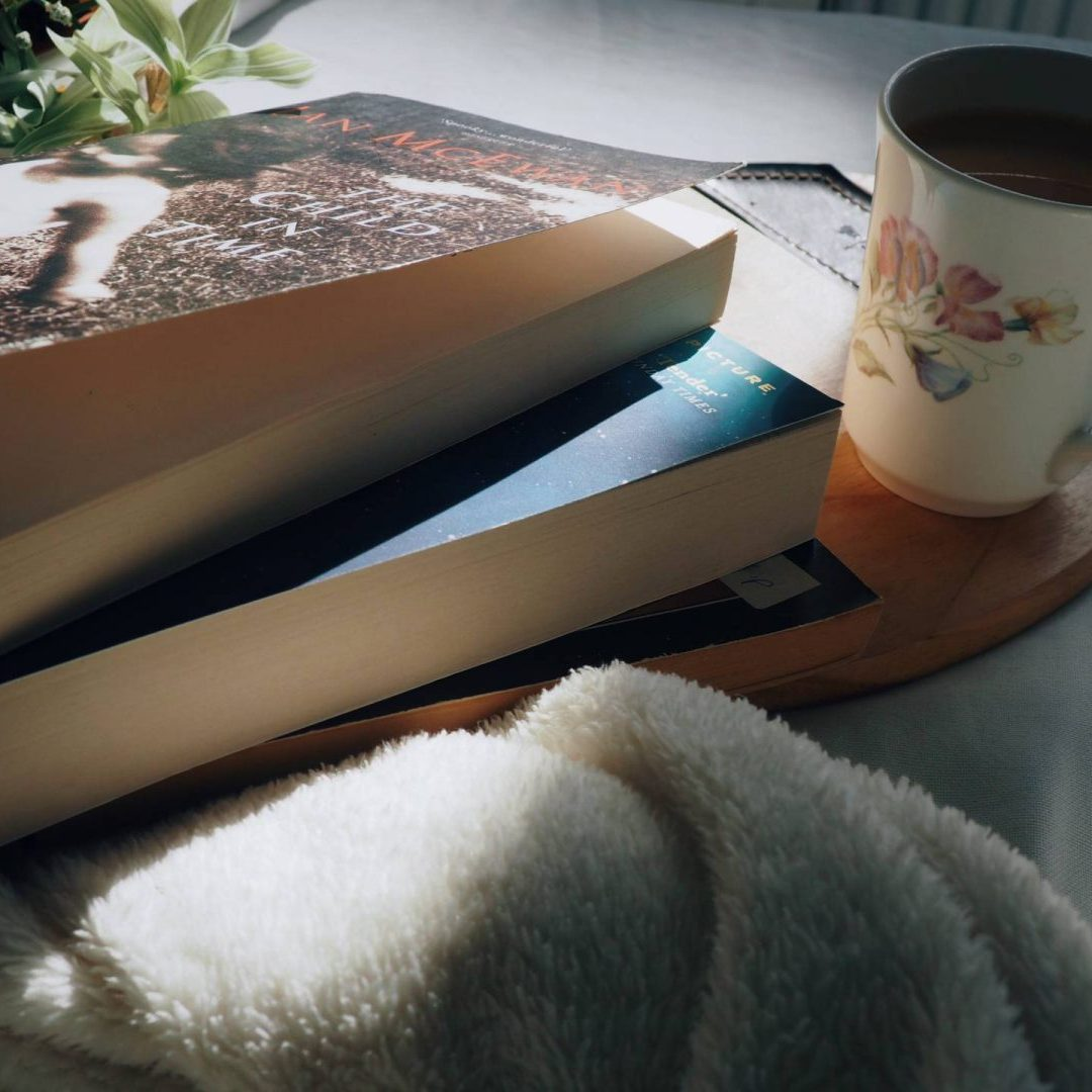 pile of books and cup of tea